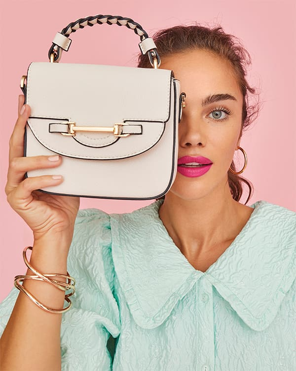 Model holding the Daydreams bag in front of her face