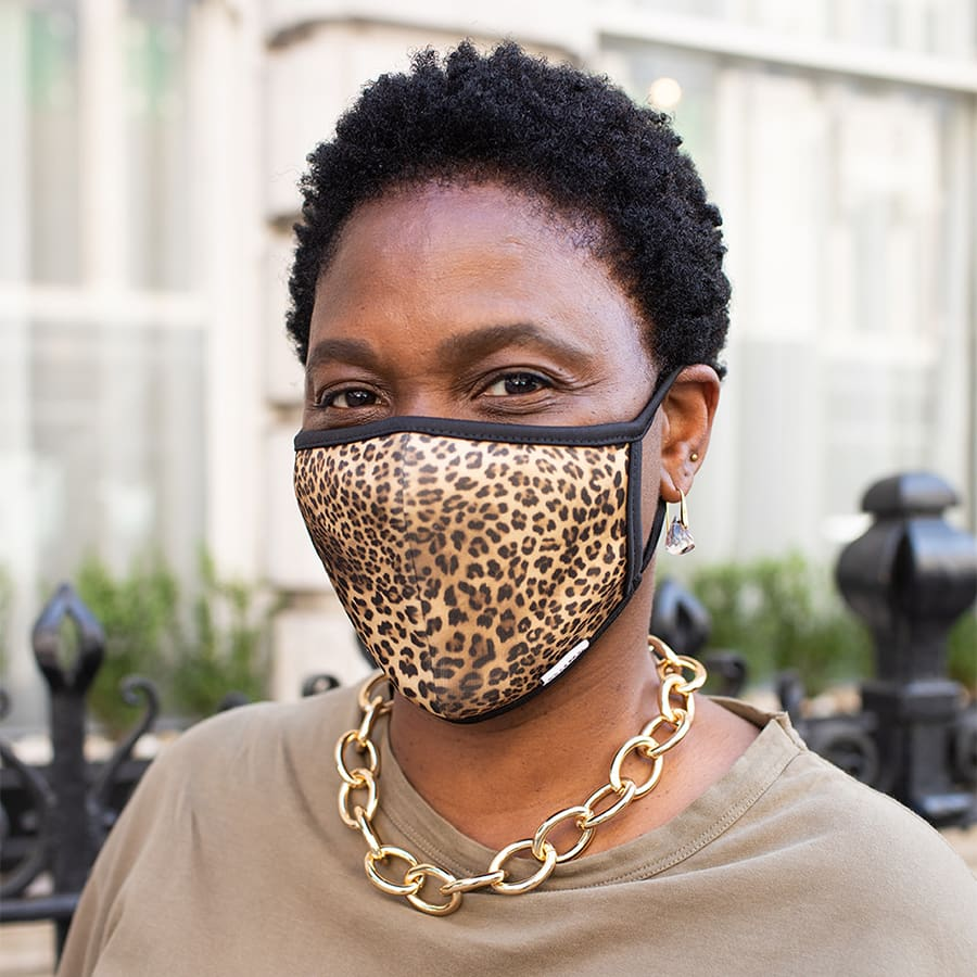 Close up of Dune London store manager wearing a face mask