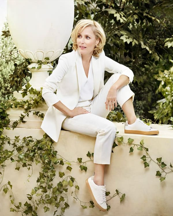 Gillian Anderson in all white wearing our eco trainer