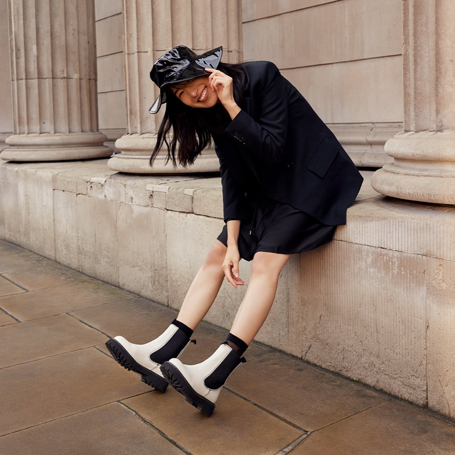 All black outfit with white Chelsea boots