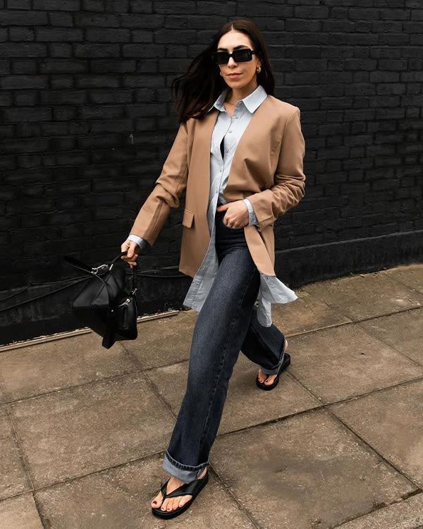 Influencer Jessica Skye wears the Longisland sandals with jeans and a blazer
