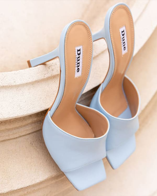 Close up of baby blue mules