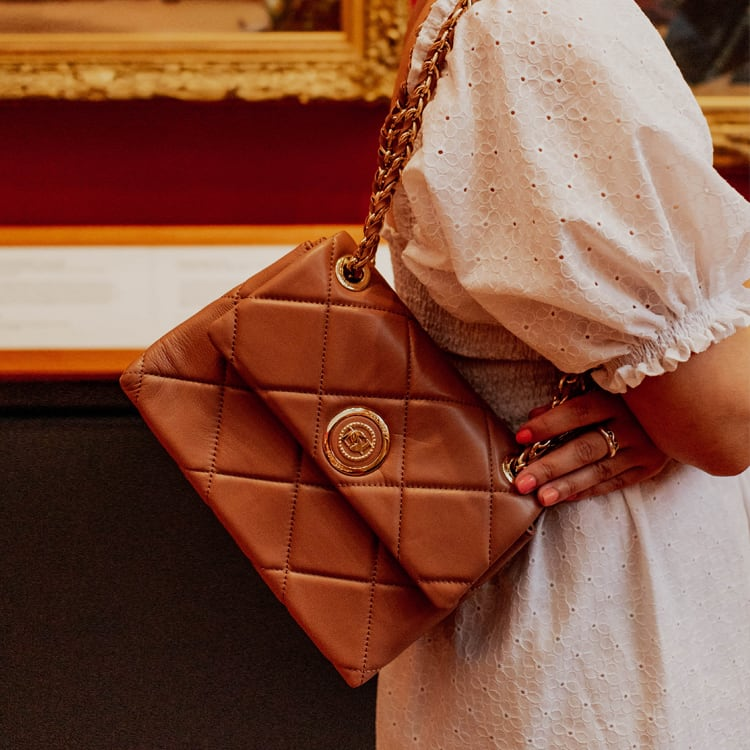 Close up of the camel leather Duchess bag
