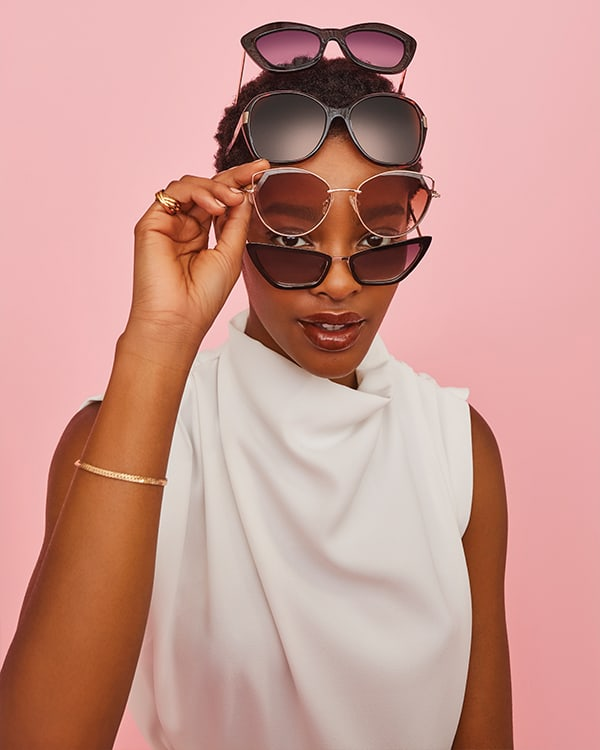 Model with multiple Dune London sunglasses on her face