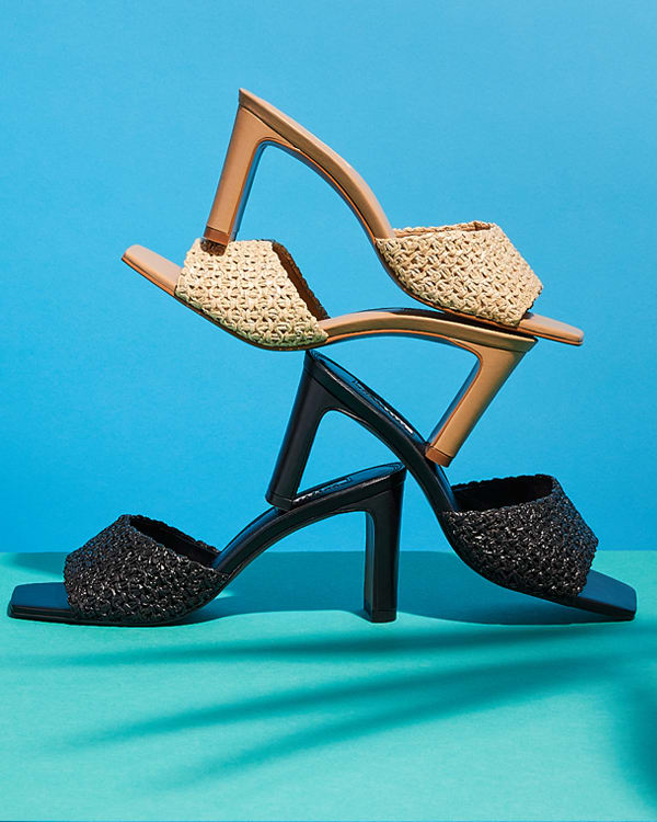 Pairs of the March raffia mules stacked on one another