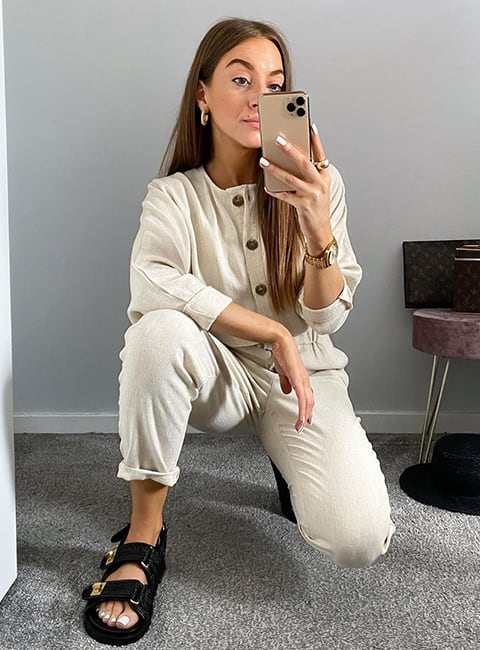 Model taking a selfie wearing the Lockstock sandal