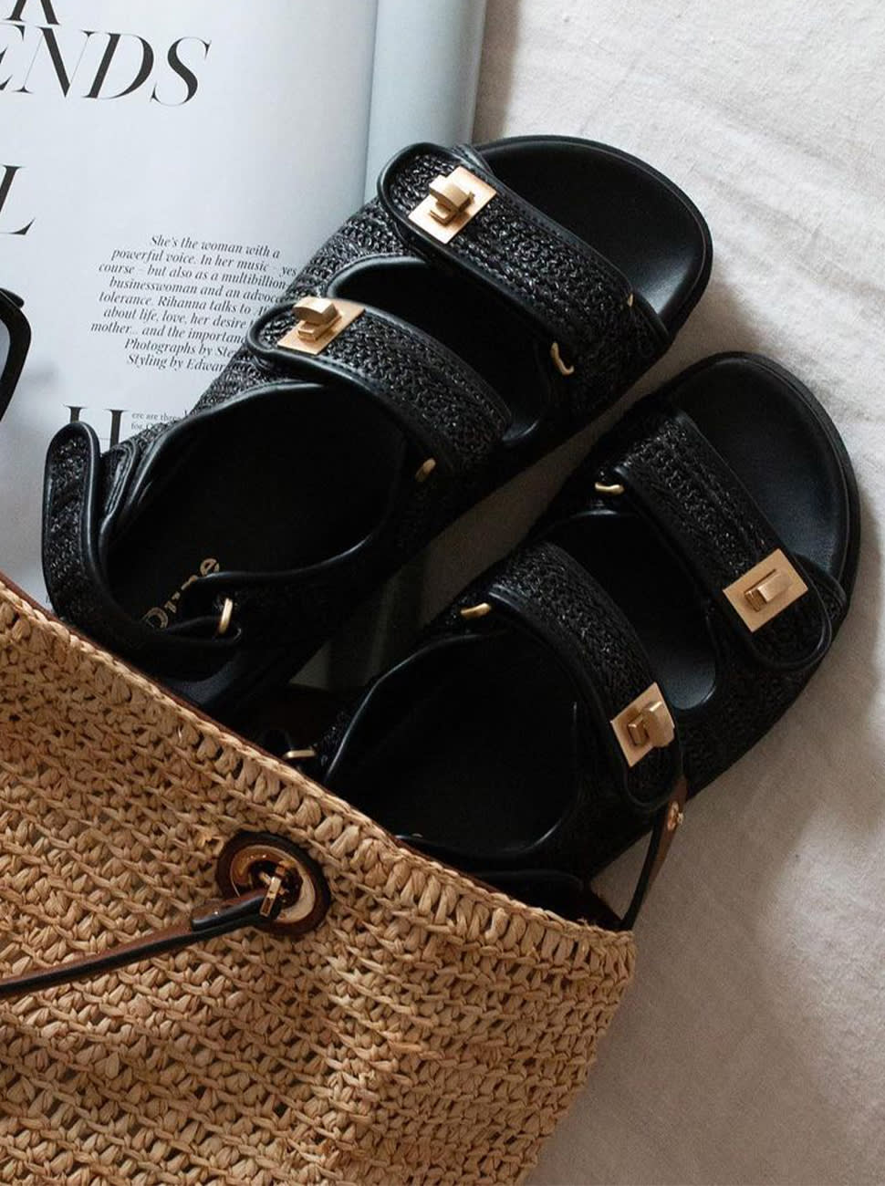 Pair of Lockstock sandals in a straw bag