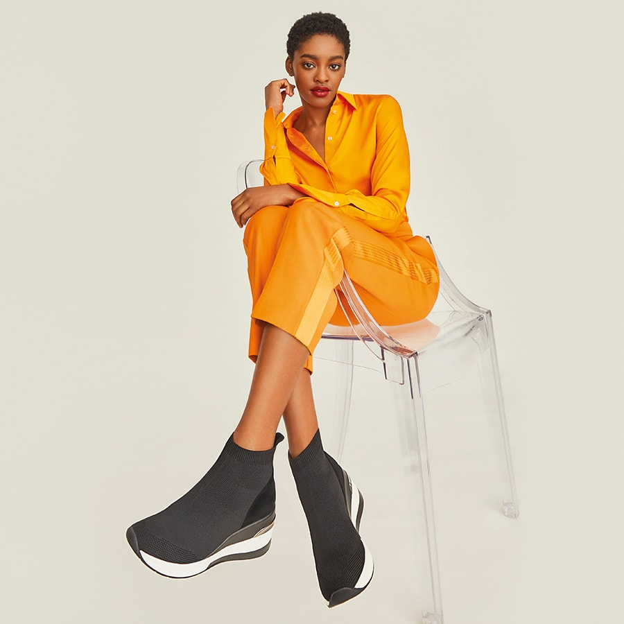 Orange outfit with black sock trainers
