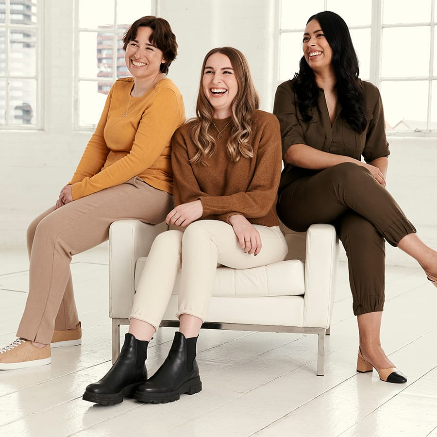 A group of three women from Dune London sitting together