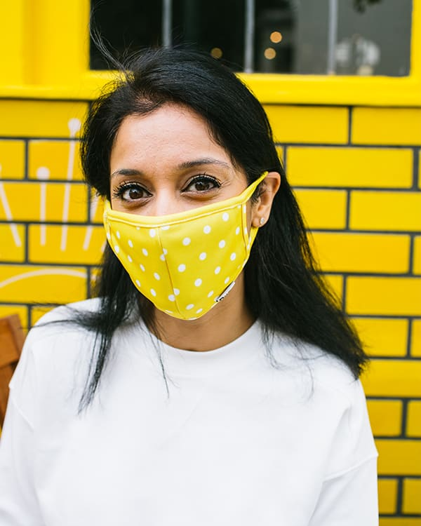 Close up of Dune London staff member wearing a face mask
