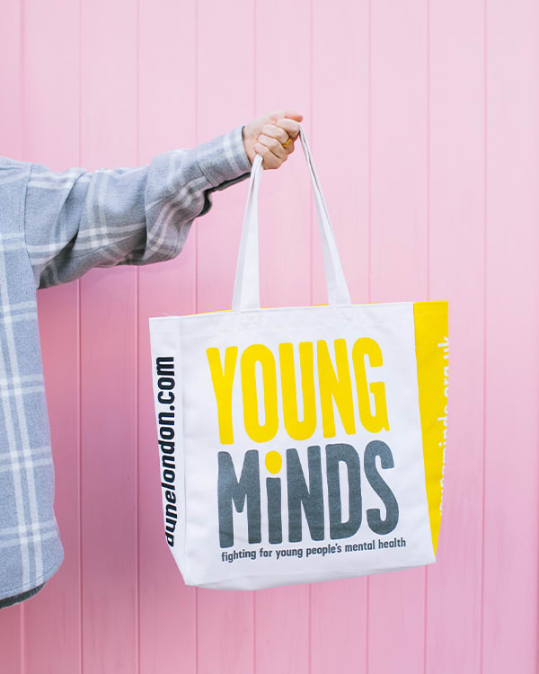 Dune London and YoungMinds-branded canvas tote bag