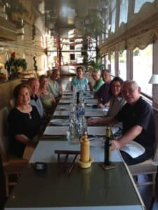 Passengers aboard Le Phenicien await dinner. Meals are planned to pair with the wines that travelers have tasted during the day at local vineyards along the Rhone River.