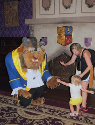 18-month-old Olivia Black is introduced to The Beast (he's referred to as The Master) in his castle which is where tiny tot lunches and dinners are staged. The restaurant is called Be Our Guest.
