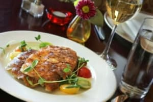 Fresh mountain trout pairs perfectly with glasses of Traminette, the gentle white wine from Paradise Hills.
