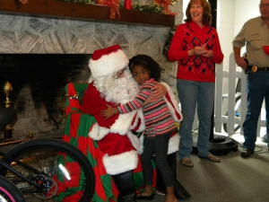 """With White Springs' mayor Dr. Helen Miller looking on, hugs and gifts are exchanged at """"Breakfast With Santa."""""""