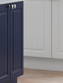 Close up of Premier Stockholm kitchen doors in Pure White and True Matt Marine Blue