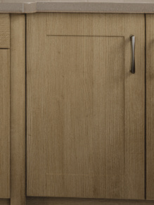 Close up of Shaker Cologne kitchen doors in Pure White and Trojan Oak