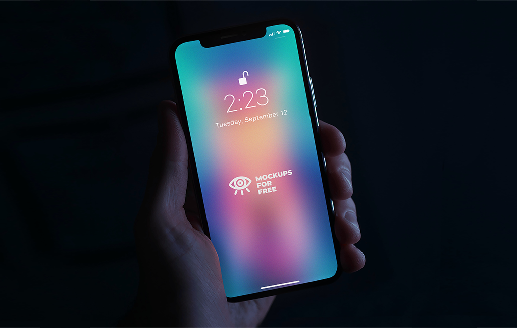 iPhoneX in hand Free PSD Mockup