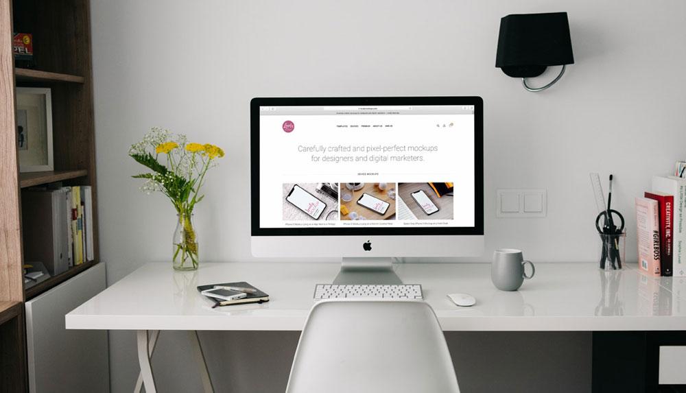 iMac Mockup On A White Table
