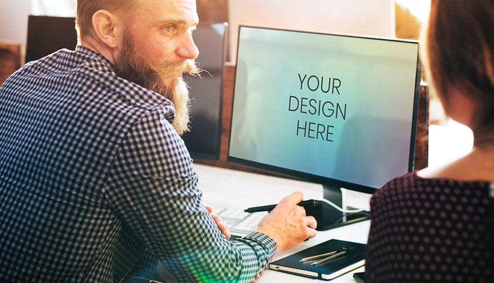 Man using a Computer Screen Mockup