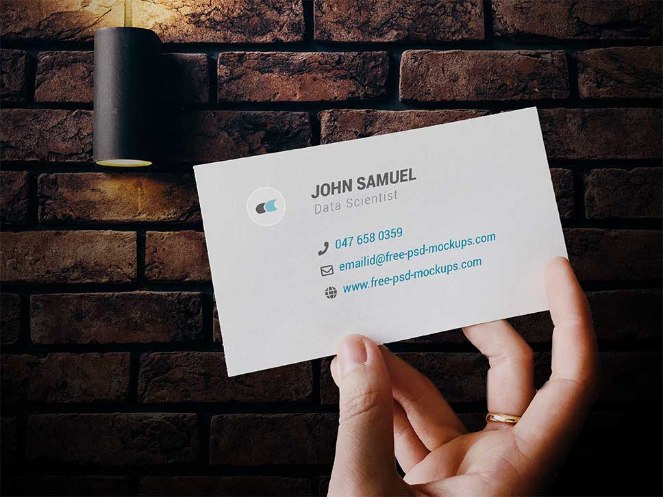 Holding Hand Front Business Card Mockup PSD