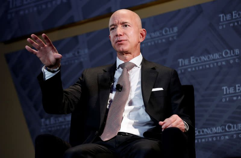 Bezos, Musk top Forbes' record-setting billionaire list