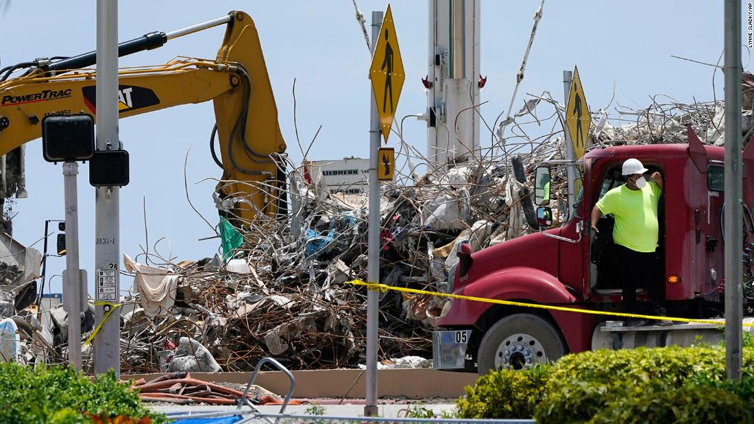 The death toll in the Surfside condo collapse has risen to 97
