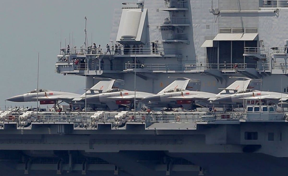 Satellite photos show China's new aircraft carrier coming together quickly and reveals more about its design