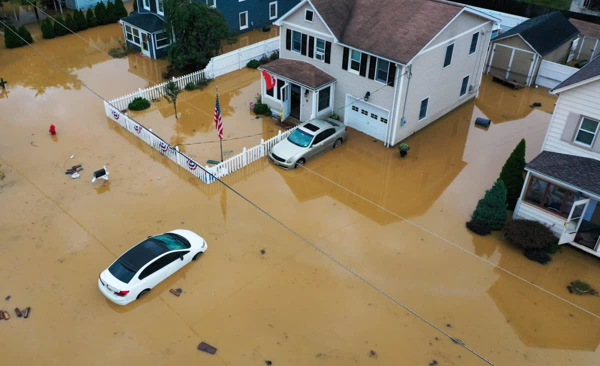 Startling photos capture East Coast flooding and wreckage from Tropical Storm Henri