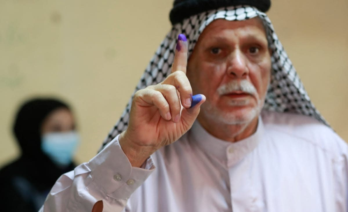 Iraqi voters head to the polls in test for democratic system