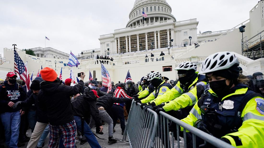 US Capitol secured after rioters stormed the halls of Congress to block Biden's win
