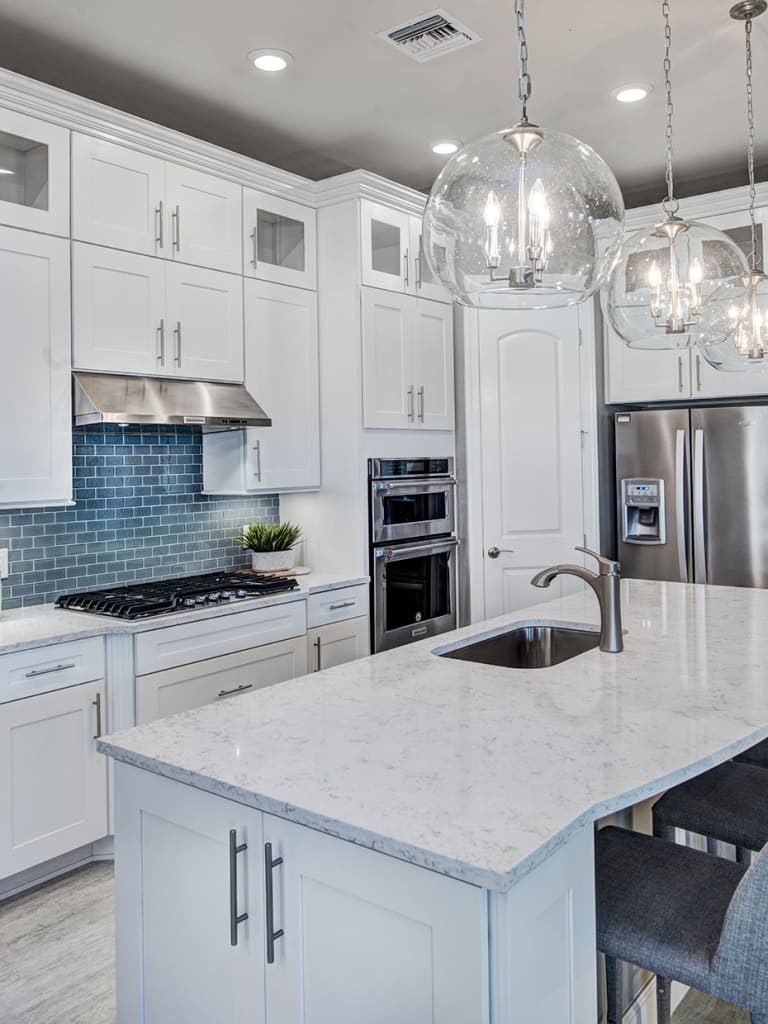 Kitchen Featuring Built In Gas Appliances, Quartz Countertops, And Diamond  Vibe Cabinets