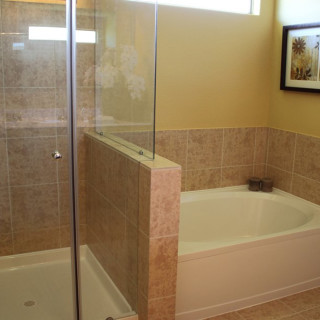 Garden Tub/Shower w/half wall and glass enclosure in the Owners Bath