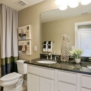 Example of Granite Countertops, Brushed Nickel Fixture Package and Comfort Height Vanity Cabinets