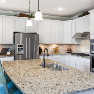 Pendant Lights and Recessed Can Lighting in Kitchen