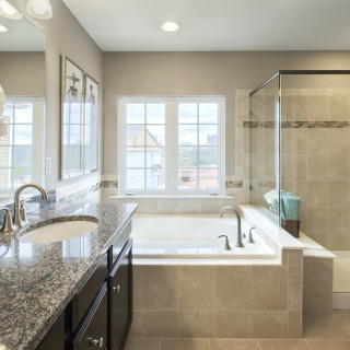 Upgraded level 2 tile in owner's bath