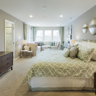Recessed lighting in the owner's bedroom