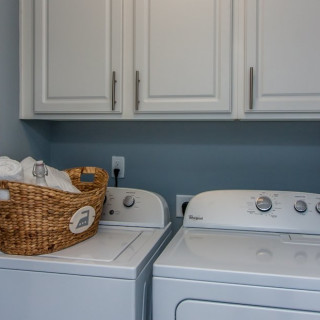 The Prestige Package: Laundry room with cabinets