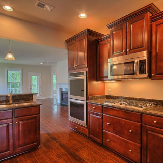 Prestige package includes a Gourmet Kitchen with raised panel cherry cabinets