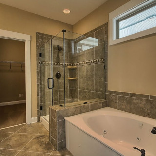 Preferred Plus package include upgraded tile in all baths and owner's shower surrounds