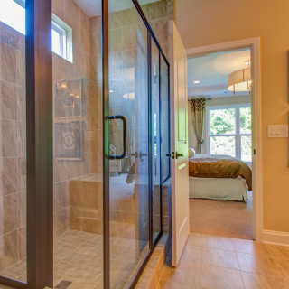 Luxury Owner's Bathroom with tile and bronze fixutres (images from Vanderbilt Model)