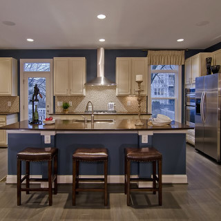 Granite countertops and tiled backsplash
