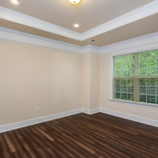 Tray ceiling and hardwood in owner's suite