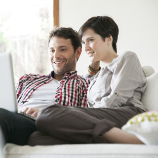 2016 Centex Stock Images, 1240 x 1240 Square Crop, Mycentexbenefits_702_couplesearchgforhomeonline_1240x1240.jpg; Couple relaxing together on sofa with laptop computer
