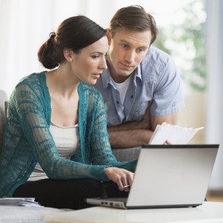 2016 Centex Stock Images, 1240 x 1240 Square Crop, 5finsteps_660_reviewingdocs_1240x1240.jpg; USA, New Jersey, Jersey City, Couple using laptop together to pay bills