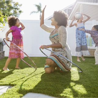 2016 Centex Stock Images, 1240 x 1240 Square Crop, 5finasteps_661_familyinyard_1240x1240.jpg; Cheerful mother and daughter with hula hoops giving high five on lawn