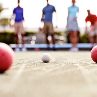 playing bocce ball in a Del Web active adult community