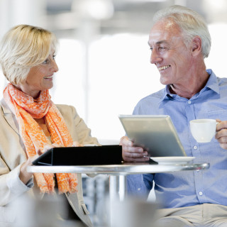Getty Stock Images Round 2Lifestyle for financial articlesOlder Couple with documents and Computer GettyImages-183742226_1226x1226 DW.jpg901C183742226; 183742226; Smiling couple using digital tablets at cafe tableSquare Crop