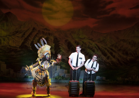 "L-R: Tsilala Brock, Liam Tobin and Jordan Matthew Brown in ""The Book of Mormon."" With book, music and lyrics by Trey Parker, Robert Lopez and Matt Stone, choreography by Casey Nicholaw and direction by Nicholaw and Parker, ""The Book of Mormon"" will be presented by Center Theatre Group at the Ahmanson Theatre February 18 through March 29, 2020. For more information, please visit CenterTheatreGroup.org. Press Contact: CTGMedia@CTGLA.org / (213) 972-7376. Photo by Julieta Cervantes."