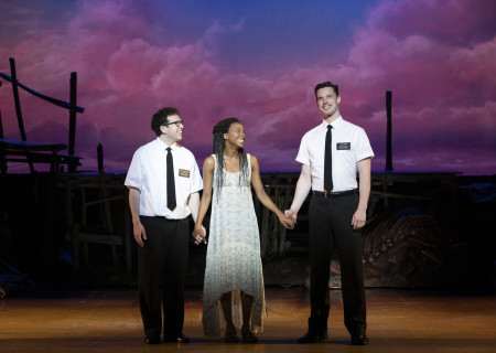 "L-R: Jordan Matthew Brown, Alyah Chanelle Scott and Liam Tobin in ""The Book of Mormon."" With book, music and lyrics by Trey Parker, Robert Lopez and Matt Stone, choreography by Casey Nicholaw and direction by Nicholaw and Parker, ""The Book of Mormon"" will be presented by Center Theatre Group at the Ahmanson Theatre February 18 through March 29, 2020. For more information, please visit CenterTheatreGroup.org. Press Contact: CTGMedia@CTGLA.org / (213) 972-7376. Photo by Julieta Cervantes."